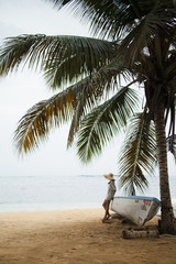 A young woman on a secluded beach on the Samana Peninsula in the Dominican Republic.
