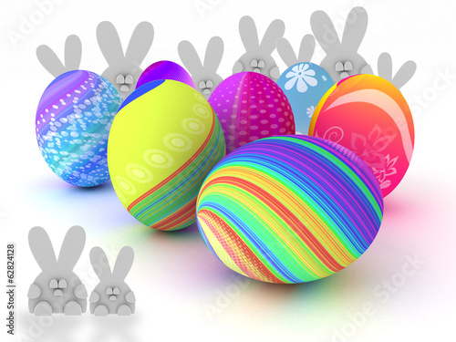 Easter bunnies and colorful eggs isolated on white background