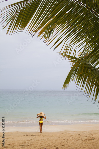 A young woman on secluded beach on the Samana Peninsula in the Dominican Republic.