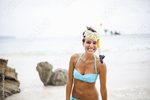 A young woman wearing snorkelling gear on the Samana Peninsula in the Dominican Republic.