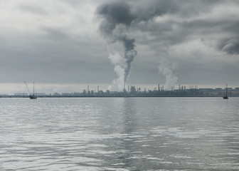 Smoke from oil refinery rising towards sky at Anacortes in Puget Sound. Washington, USA