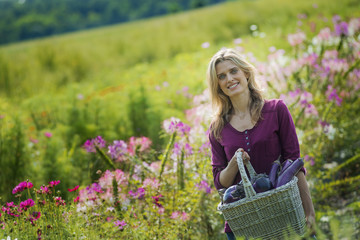 A woman in a garden full of flowers on an organic flower farm.