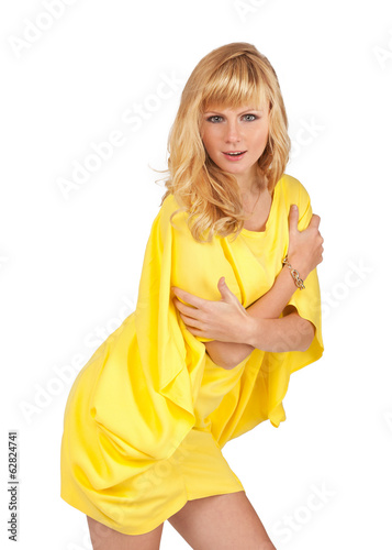 beautiful young blond woman in yellow dress, isolated on white b
