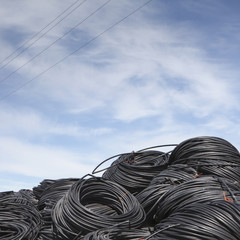 Heap of coiled plastic irrigation tubing.