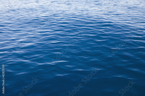 Blue lake water with small ripples