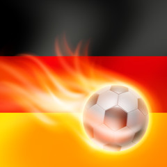 Burning football on Germany flag background
