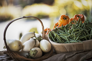 Organic Vegetable on Display; Organic White Eggplant; Green Beans; Yellow and Red Bell Peppers