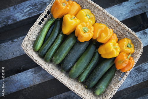 Organic Zucchini in basket with Yellow and Orange Bell Peppers