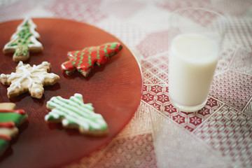 Organic homemade Christmas cookies and a glass of milk.
