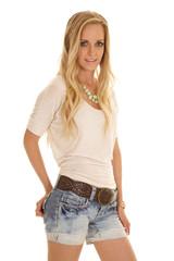 woman light shirt denim shorts stand looking