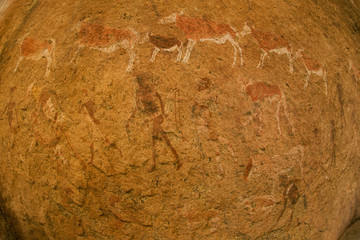 Close of the impressions, ancient rock art of animals and people made on the surface of the rock at  Twyfelfontein World Heritage Site at Uibasen Conservancy, Damaraland, Namibia.