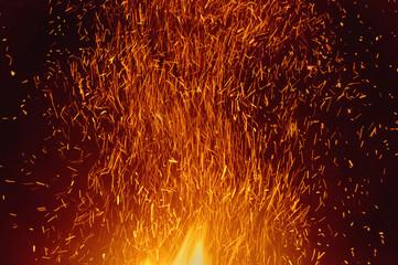 Sparks rising from bonfire, Bonny Doon, Monterey Bay, California