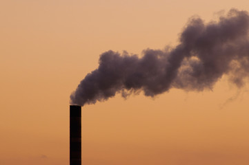 A thick plume of smoke rising from a chimney stack at a coal-fuelled power plant, Fernandina Beach, Florida, USA