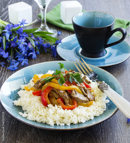 Beef with peppers and rice the Asian way.