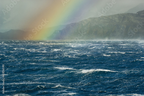 Rainbow over the stormy sea off South Georgia Island in the South Atlantic Ocean.