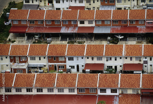 Modern houses in an area previously covered with lowland forest, and now cleared. An aerial view, Sabah, Borneo