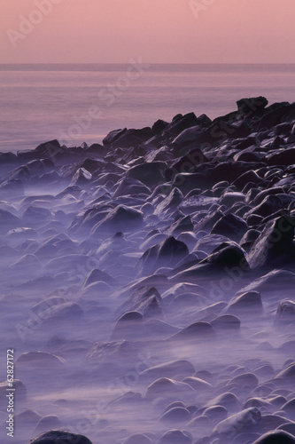 Rocky beach at twilight, Galapagos Islands