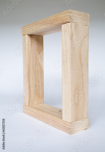 A box shape, four pieces of wood fitted together. Spruce treated  2x4 wood studs, creating a square frame.