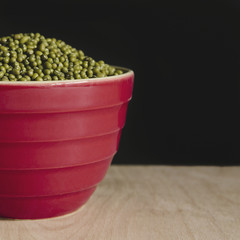 Bowl of mung beans (a legume also know as green gram or golden gram)