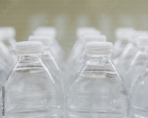 Rows of water-filled plastic bottles with screw caps.