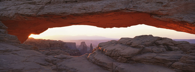 The Mesa Arch, a natural eroded rock arch, in Canyonlands National Park.