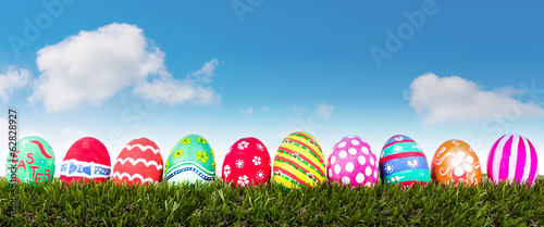 Easter Eggs on Fresh Green Grass over blue sky