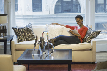 Woman relaxing at home reading