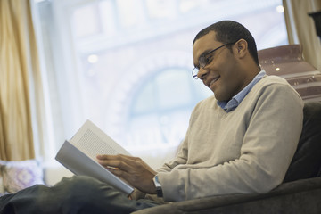 Man relaxing at home reading