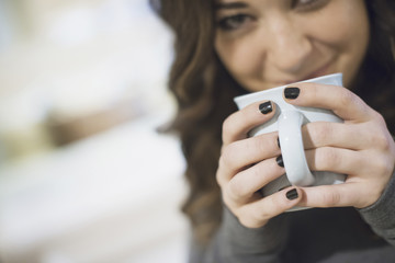 Woman relaxing at home with coffee