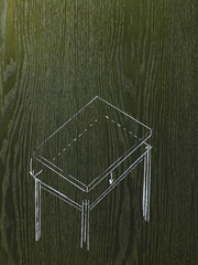 A line drawing image on a natural wood grain background. A rectangular table with a detached top.