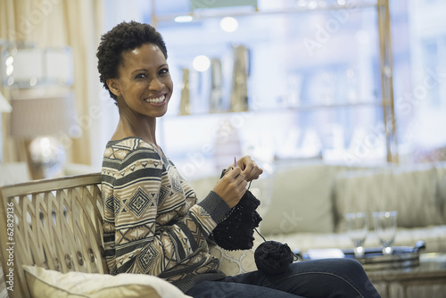 Woman relaxing at home with knitting