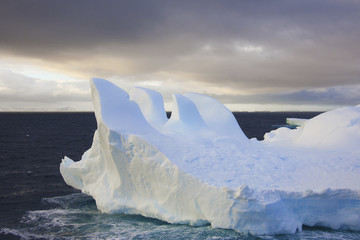 Icebergs floating on the Antarctic southern oceans. Eroded by wind and weather, creating interesting shapes.