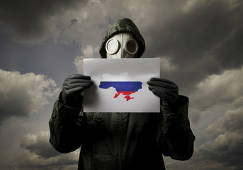 Gas mask and Ukraine map with Russian flag