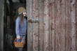 An organic farm in upstate New York, in winter. A girl in a barn doorway with a basket.