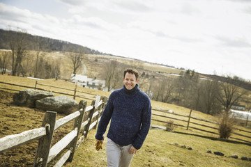 An Organic Farm in Winter in Cold Spring, New York State. A man working outdoors on the farm.
