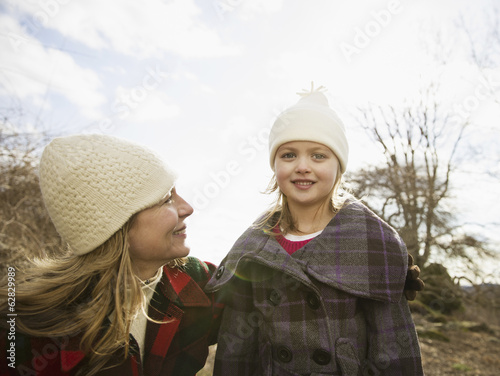 An Organic Farm in Winter in Cold Spring, New York State. A woman and child wrapped up against the cold weather.