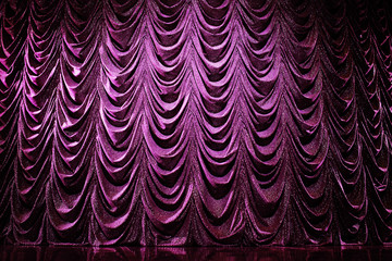 Brightly lit curtains in theatre