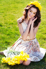 Happy smiling girl with yellow flowers