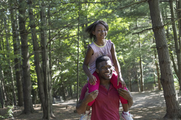 A man giving a young girl a piggyback.