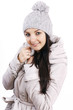 Beautiful young woman wearing jacket and cap