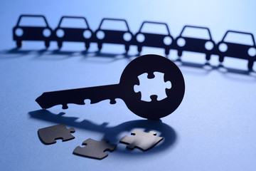 puzzle key and cars in chain cut