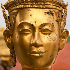 Statue face at the Grand Palace, Bangkok, Thailand