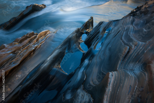 Textured rock at the edge of a stream, Jasper National Park, Alberta, Canada