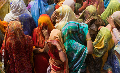 A colourful crowd of people celebrate the Holi Festival, Mathura, Uttar Pradesh, India