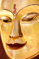 Sculpture of a Buddha. Close up of the face, Mandalay, Myanmar