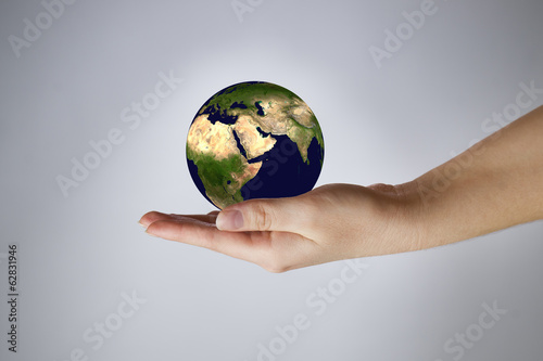 The Earth in a female hand