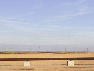 Elevated oil pipeline in the Midway-Sunset oil fields, the largest shale oil field in California.