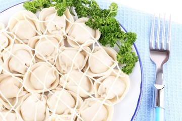 Meat dumplings - russian boiled pelmeni in plate