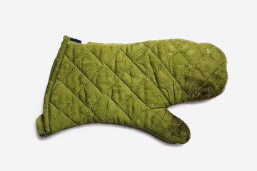 Used Oven Mitt. A quilted padded fabric, green, heat resistant mitt.