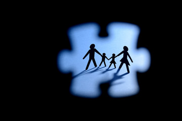 paper figure of family through puzzle shape view